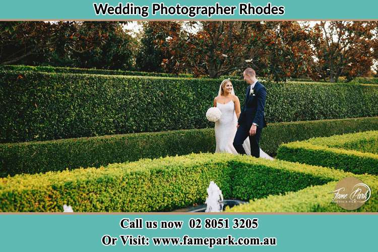 Photo of the Bride and the Groom walking at the garden Rhodes NSW 2138
