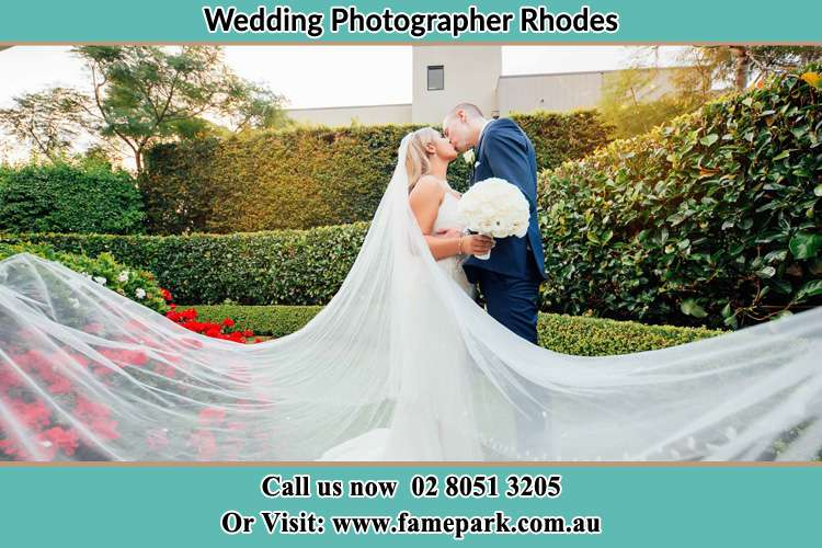 Photo of the Bride and the Groom kissing at the garden Rhodes NSW 2138