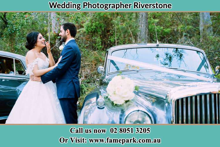 Photo of the Bride and the Groom near the bridal car Riverstone NSW 2765