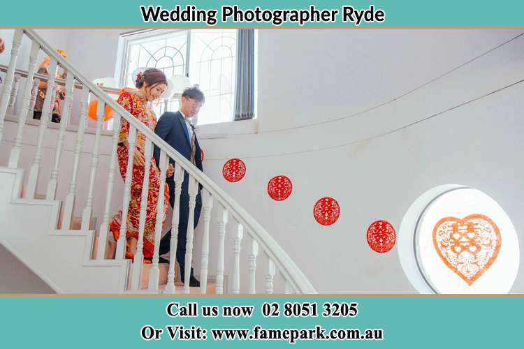 Photo of the Bride and the Groom going down the stair Ryde NSW 2112