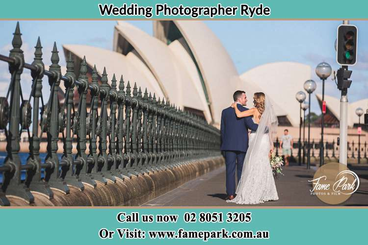 The Groom and the Bride walking towards the Sydney Grand Opera House Ryde NSW 2112