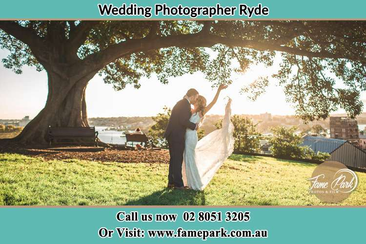 Photo of the Bride and the Groom kissing under the tree Ryde NSW 2112