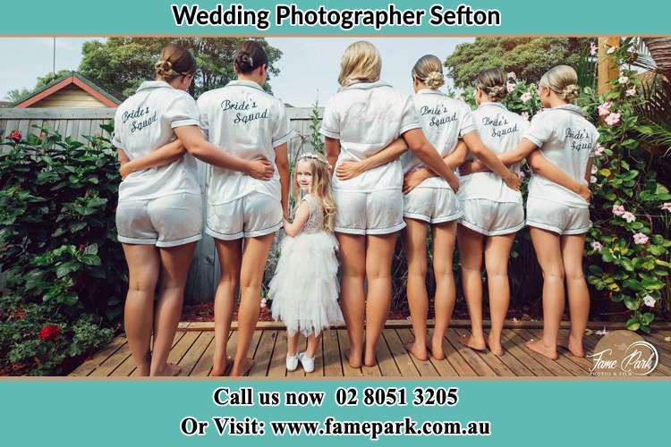 Behind photo of the Bride and the bridesmaids with the flower girl looking back Sefton NSW 2162