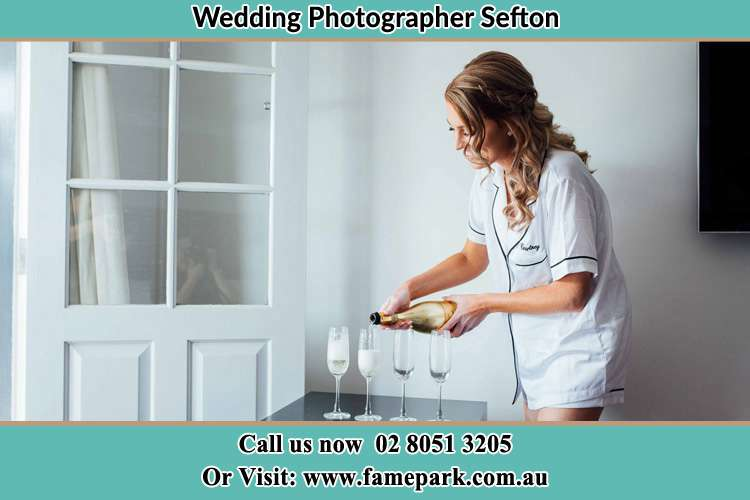 Photo of the Bride pouring wine on the glasses Sefton NSW 2162