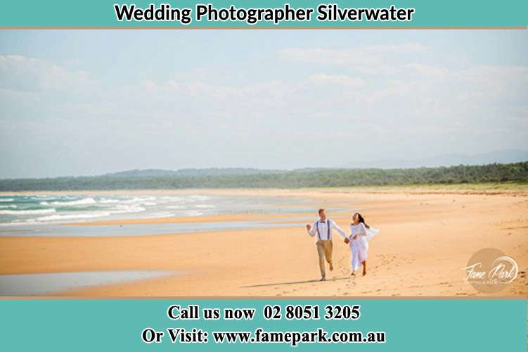 Photo of the Groom and the Bride walking at the sea shore Silverwater NSW 2128