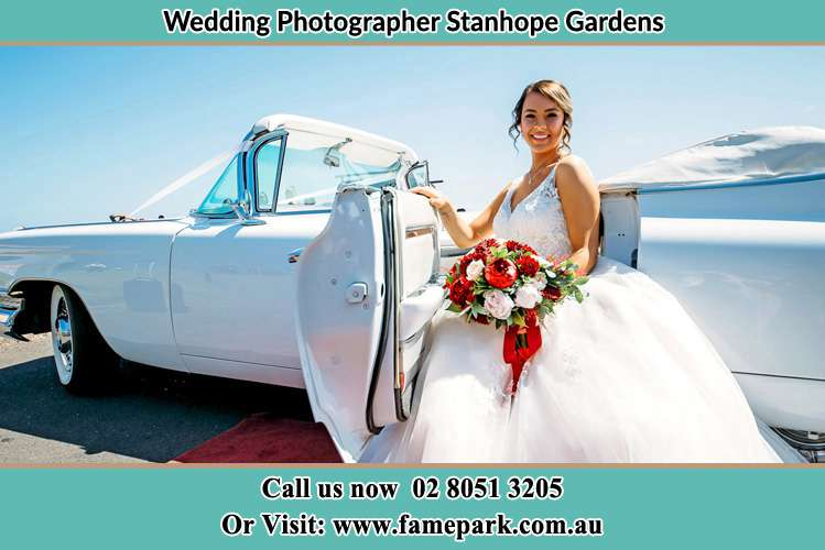 Photo of the Bride outside the bridal car Stanhope Gardens NSW 2768