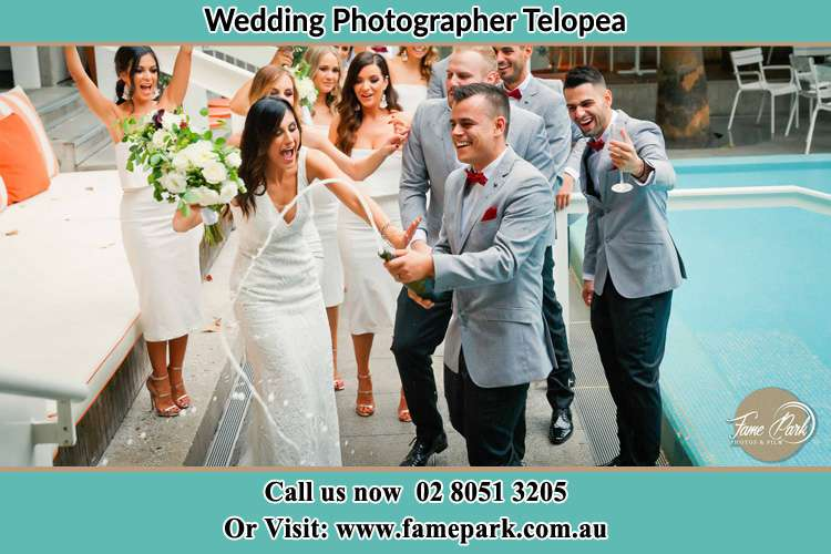 Photo of the Groom and the Bride celebrating with the secondary sponsors Telopea NSW 2117