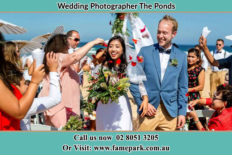 Photo of the Bride and the Groom showering flower petal by the visitors The Ponds NSW 2769