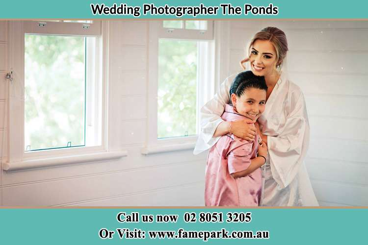 Photo of the Bride hugging the flower girl The Ponds NSW 2769