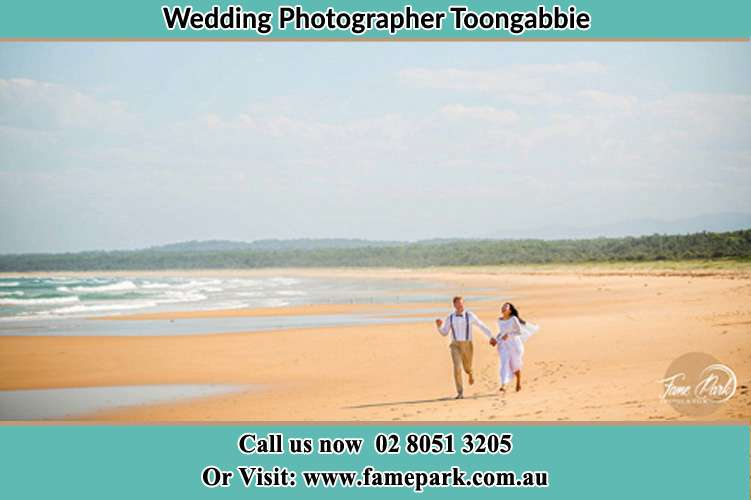 Photo of the Groom and the Bride walking at the sea shore Toongabbie NSW 2146