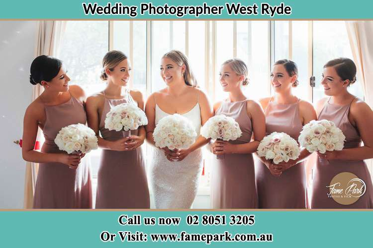 Photo of the Bride and the bridesmaids holding flower bouquet West Ryde NSW 2114